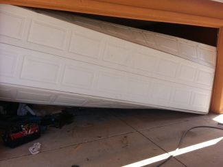 Resultes of a DIY attempt at fixing a problem garage door in Tucson