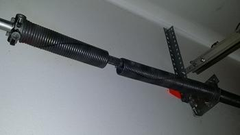 picture of a broken garage door spring